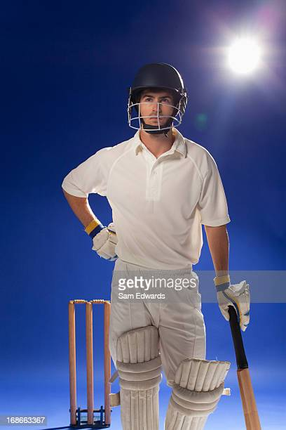 Cricket player standing with bat