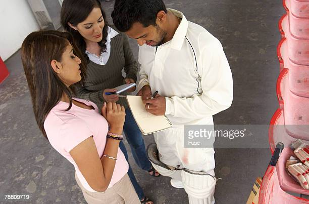 Cricket Player Taking Autographs