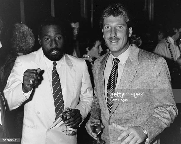 Cricket player Viv Richards and Ian Botham attending a charity party celebrating the 25th anniversary of Amnesty International, London, May 30th 1986.