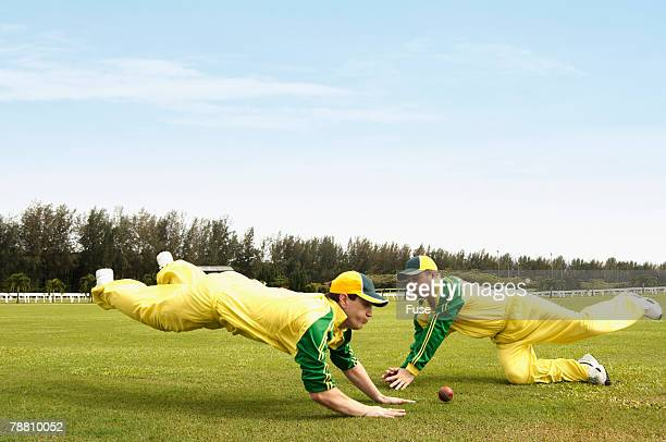 Cricket Players Diving for Ball