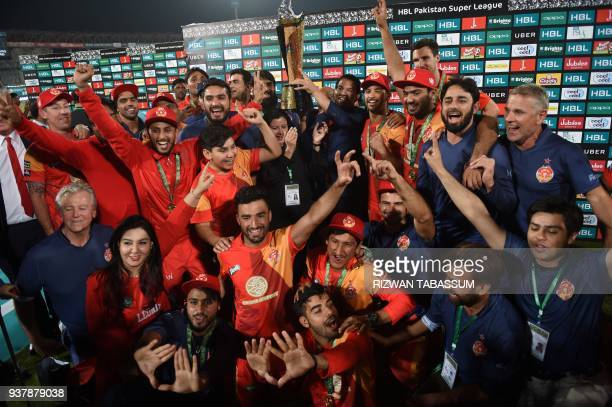 Cricket players of Islamabad United celebrate their victory at the end of the Pakistan Super League final match between Peshawar Zalmi and Islamabad...