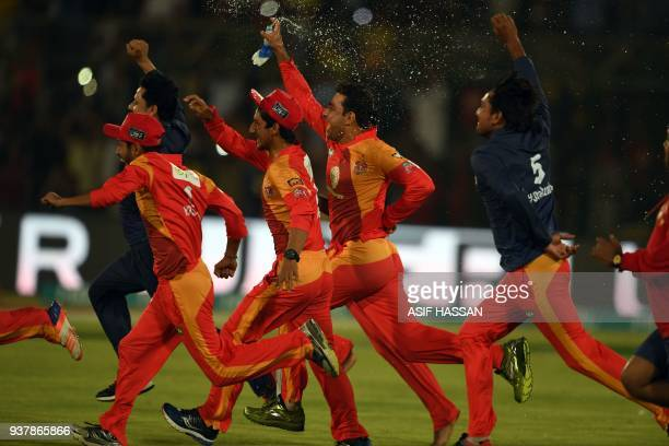 Cricket players of Islamabad United celebrates their victory at the end of the Pakistan Super League final match between Peshawar Zalmi and Islamabad...