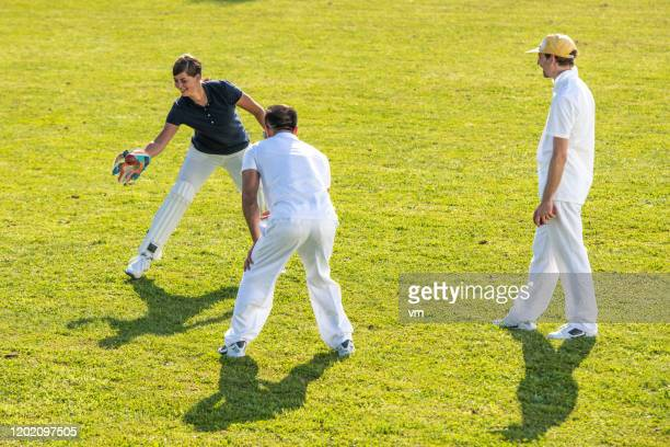 cricket players practicing and having fun - cricket player stock pictures, royalty-free photos & images