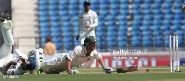 Cricket South Africa batsman AB Devilliers dives to avoid getting runout by Murali Vijay during the second day of the first test match between India...
