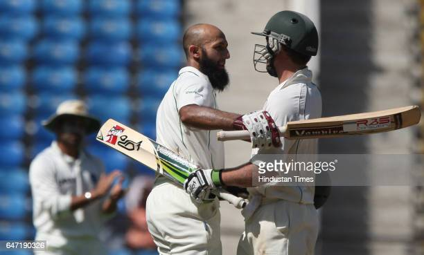 Cricket South Africa batsman Hashim Amla celebrates with AB DeVilliers after scoring double century during the second day of the first test match...
