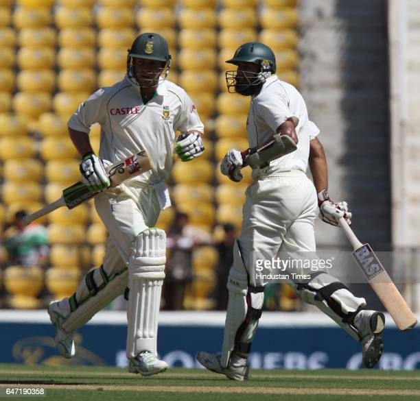 Cricket South Africa batsmen Hashim Amla and AB DeVilliers bat during the second day of the first test match between India and South Africa at VCA...
