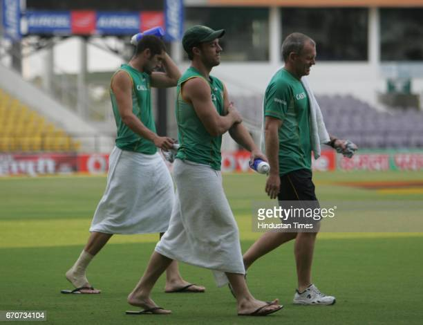 Cricket South africa's AB DeVilliers and Parnell walk wearing towel towards the swimming pool at VCA stadium after the third day of the first test...