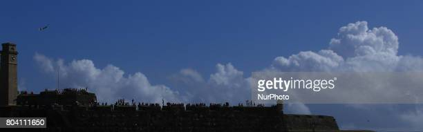 Cricket spectators watch the 1st ODI match on top of the Galle Fort at Galle International cricket ground Galle Sri Lanka on Friday 30 June 2017
