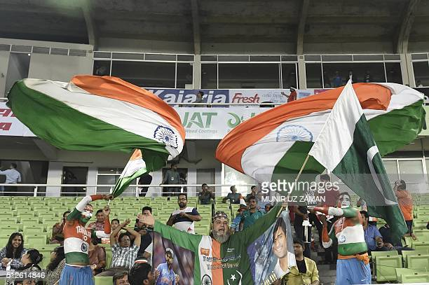 Cricket spectators wave the national flags of India and Pakistan ahead of the match between the two countries during the Asia Cup T20 cricket...