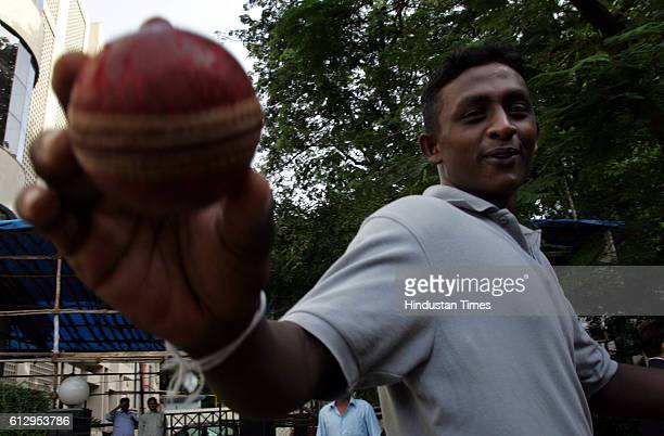 Cricket Sri Lankan Spinner Ajantha Mendis poses for photographers after a promotional event at MIG Bandra
