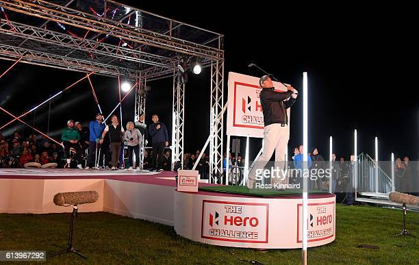 Cricket star Shane Warne hits his tee shot during the 'Hero Challenge' prior to the British Masters at The Grove on October 11 2016 in Watford England