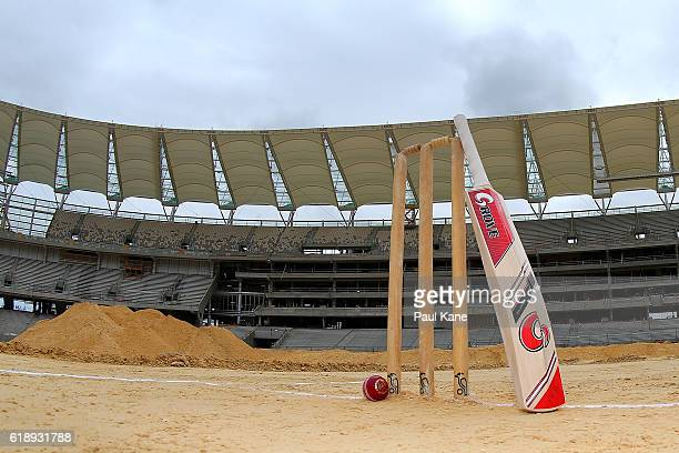 Cricket stumps bat and ball are setup on the proposed wicket area during the new Perth Stadium Tour on October 29 2016 in Perth Australia