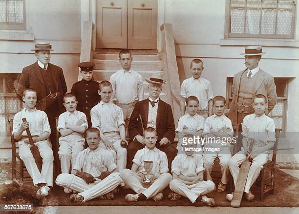 Cricket team at the Boys Home Industrial School Regent's Park Road London 1900 The school cricket team pose with a trophy and their cricket bats Two...