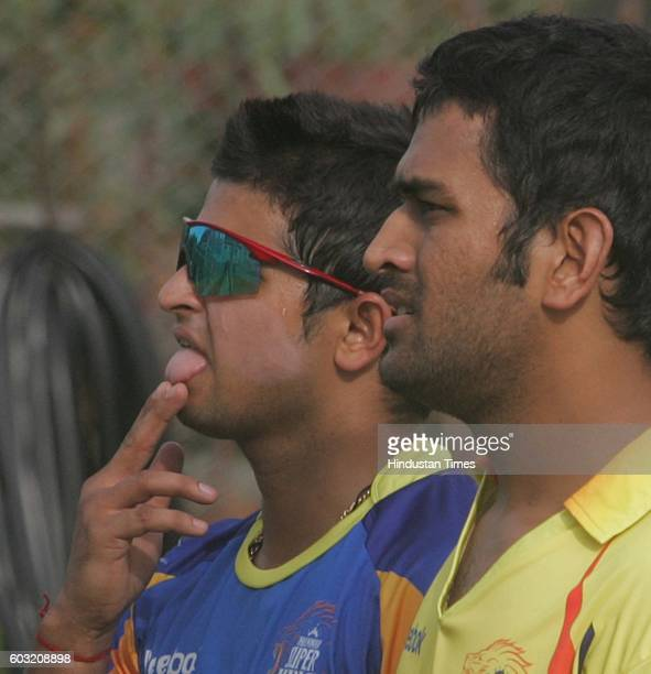 Cricket Team Chennai's captain MS Dhoni and Suresh Raina during the net practice session on the eve of their match against Team Hyderabad at Rajiv...
