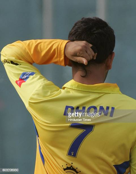 Cricket Team Chennai's captain MS Dhoni with new hair style during the net practice session on the eve of their match against Team Hyderabad at Rajiv...