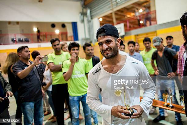 Cricket Teams celebrate the triumph of a regional tournament of teams from eastern Germany on September 17 2016 in Bischofswerda Germany Most of the...