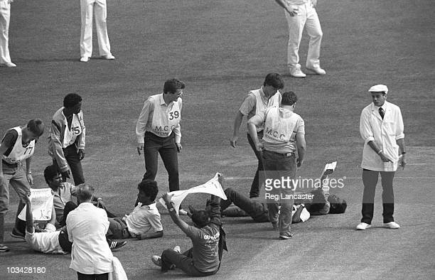 Cricket umpire Dickie Bird orders Tamil protestors to leave the pitch during a Test match between England and Sri Lanka held at Lord's in London on...