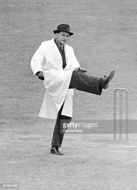Cricket umpire Frank Chester taps his raised leg to signal a leg bye July 1948