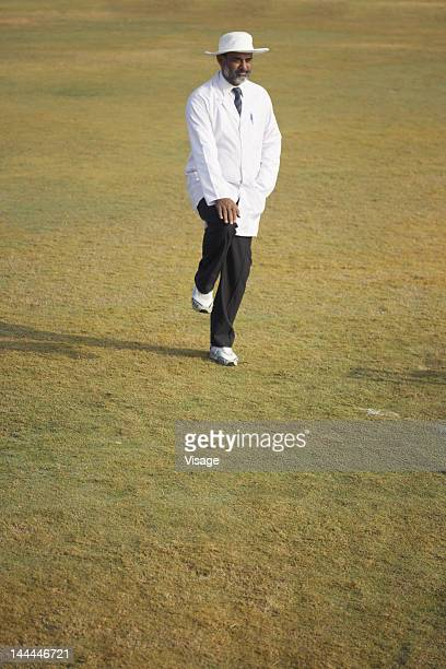 A cricket umpire on the field