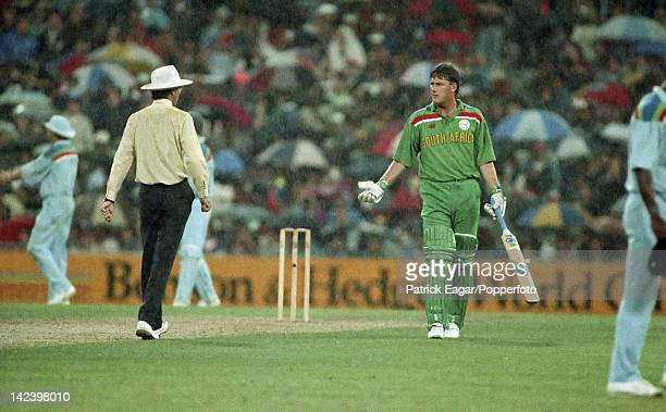 Cricket World Cup 1992 semi final England v South Africa at Sydney McMillan gestures to umpire as the rain falls 65828_23