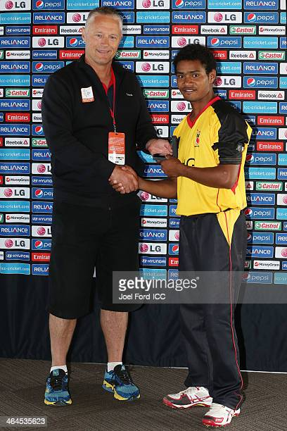 Cricket World Cup Operations Manager Gavin Larsen presents Lega Siaka of Papua New with the man of the match award after an ICC World Cup qualifying...