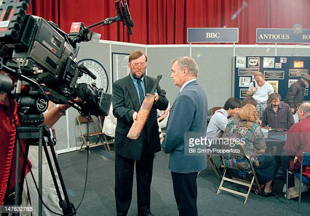 Cricket writer and historian David Frith is interviewed by Mike Ashton during a recording of the BBC Television programme Antiques Roadshow filmed at...