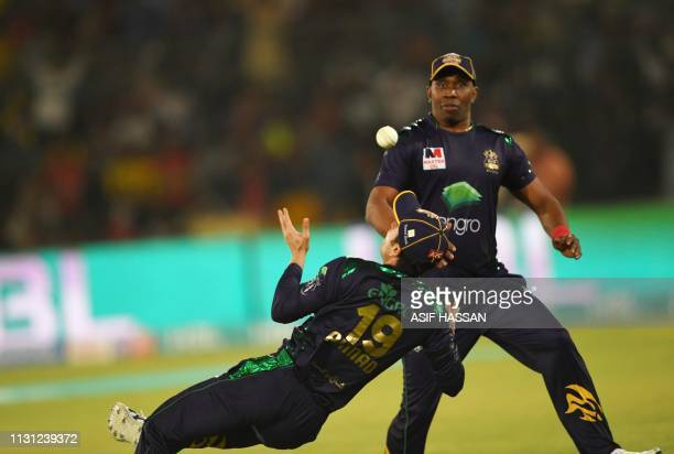 Cricketer Ahmad Shahzad of Quetta Gladiators drops a catch as Dwayne Bravo looks on in the final of Twenty20 Pakistan Super League at the National...