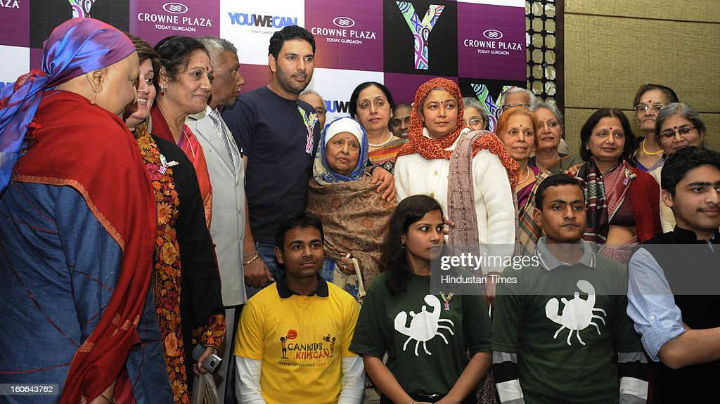 Cricketer and cancer survivor Yuvraj Singh with other cancer survivors at a program on World Cancer Day on February 4, 2013 in Gurgaon, India.