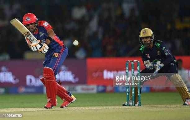 Cricketer Babar Azam of Karachi Kings plays a shot during the second match of the last eight matches of its domestic Twenty20 League at the National...