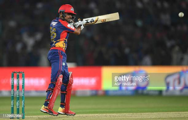 Cricketer Babar Azam of Karachi Kings plays a shot in the National Cricket Stadium during the second match of the last eight matches of its domestic...