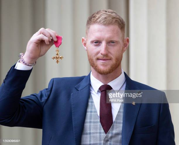 Cricketer Ben Stokes poses with his OBE that he was awarded for service to cricket following an investiture ceremony at Buckingham Palace on February...