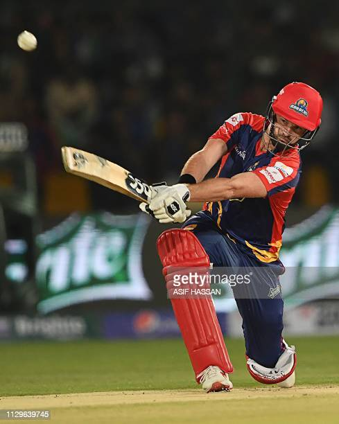 Cricketer Colin Munro of Karachi Kings plays a shot during the second match of the last eight matches of its domestic Twenty20 League at the National...