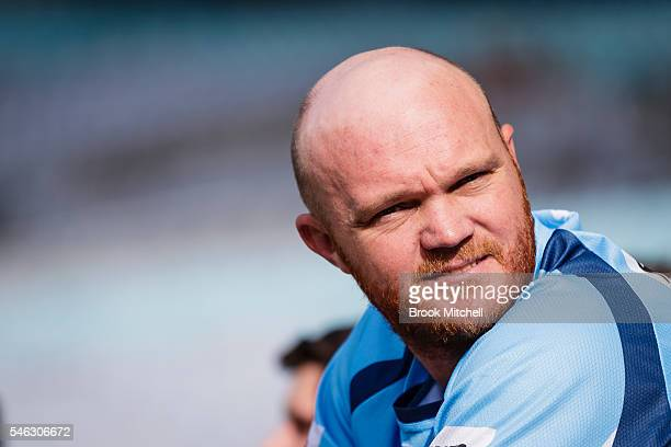 Cricketer Doug Bollinger watches on during the New South Wales Blues State of Origin captain's run at ANZ Stadium on July 12 2016 in Sydney Australia