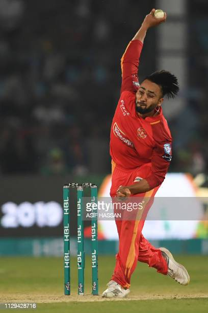 Cricketer Faheem Ashraf of Islamabad United delivers a ball during the first match of the last eight matches of the Pakistan domestic Twenty20 League...