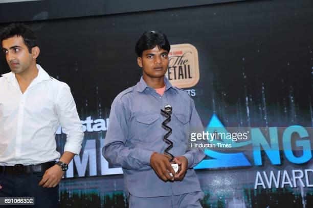 Cricketer Gautam Gambhir with Taxi driver and Game Changer Awardee Debendra Kapri during the Hindustan Times Game Changer Awards 2017 at Hotel Oberoi...