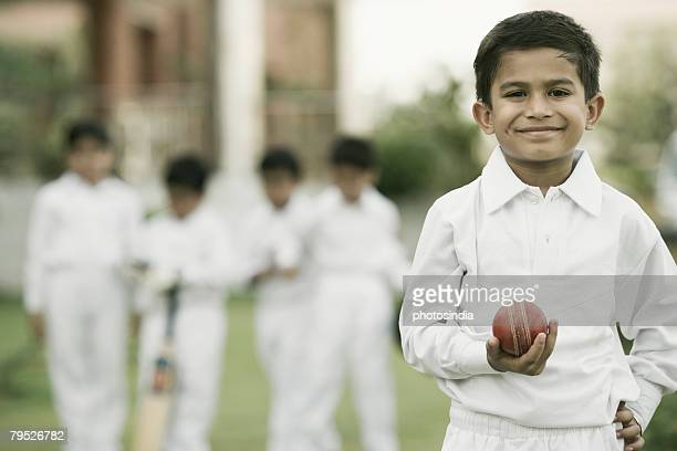 cricketer holding a cricket ball and smiling - cricket player stock pictures, royalty-free photos & images