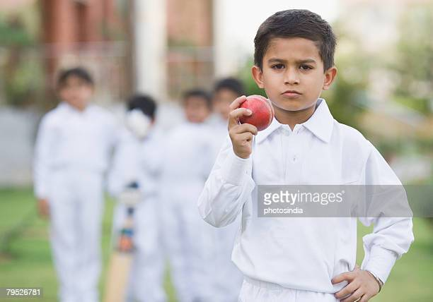 Cricketer holding a cricket ball