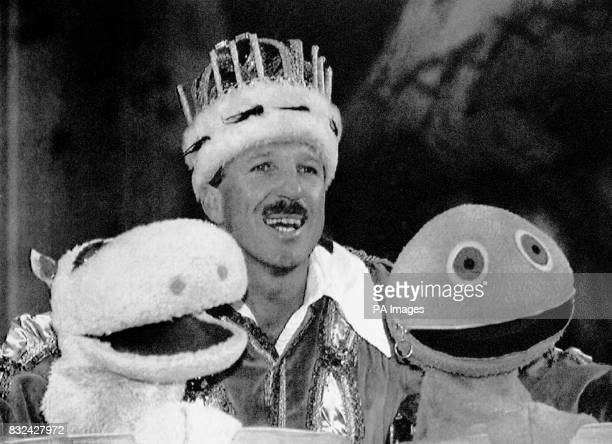 Cricketer Ian Botham pictured during rehearsals with his costars George and Zippy from children's television programme Rainbow