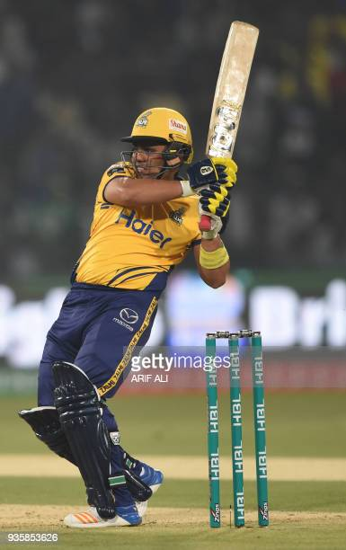 Cricketer Kamran Akmal of Peshawar Zalmi plays a shot during the Twenty20 cricket match of the Pakistan Super League between Peshawar Zalmi and...
