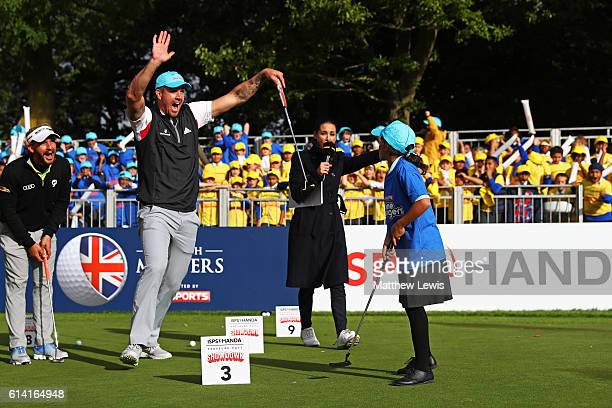 Cricketer Kevin Petersen and Amena Monib celebrate a putt during the ISPS Handa Pressure Putt Showdown at The Grove on October 12 2016 in Watford...