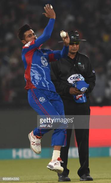 Cricketer Mohammad Amir of Karachi King delivers the ball during the Twenty20 cricket match of the Pakistan Super League between Peshawar Zalmi and...