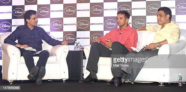 Cricketer Rahul Dravid and Sanjay Manjrekar with commentator Harsha Bhogle during unveiling of Disney and ESPN cricinfo's Timeless Steel book in...