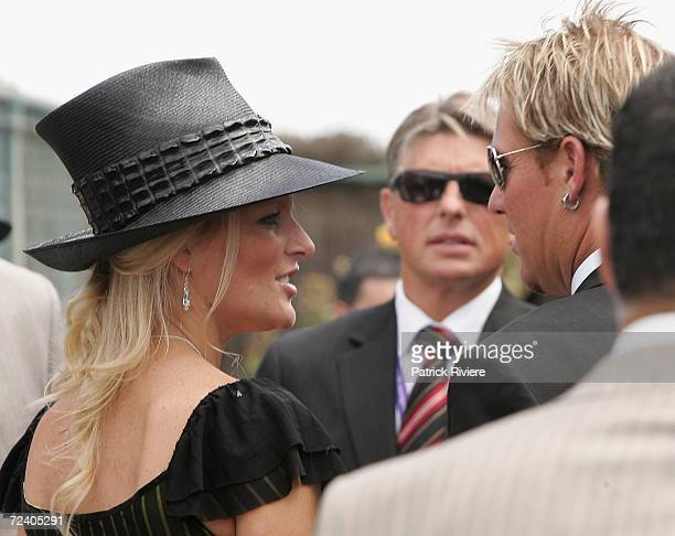 Cricketer Shane Warne and his wife Simone meet in the Birdcage at the AAMI Victoria Derby Day part of the four day Melbourne Cup Carnival at...