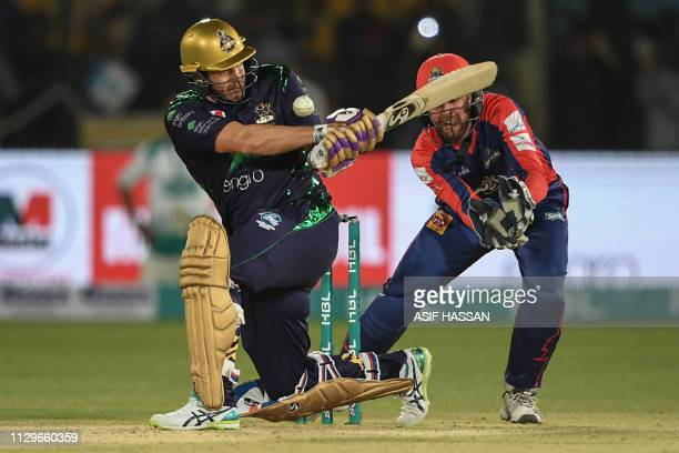 Cricketer Shane Watson of Quetta Gladiators plays a shot in the National Cricket Stadium during the second match of the last eight matches of its...