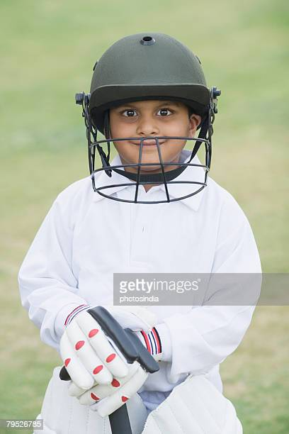 cricketer standing in a cricket field - cricket player stock pictures, royalty-free photos & images