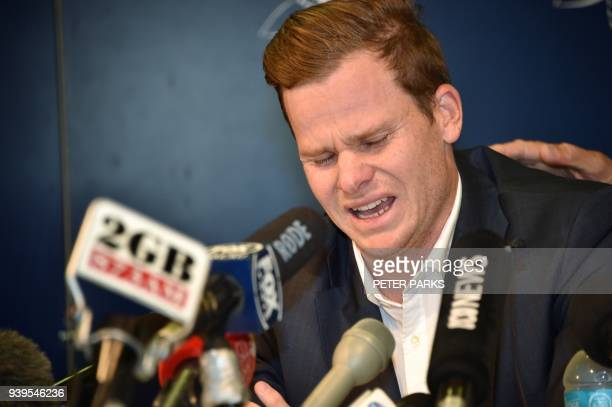 TOPSHOT Cricketer Steve Smith reacts at a press conference at the airport in Sydney on March 29 after returning from South Africa Distraught...