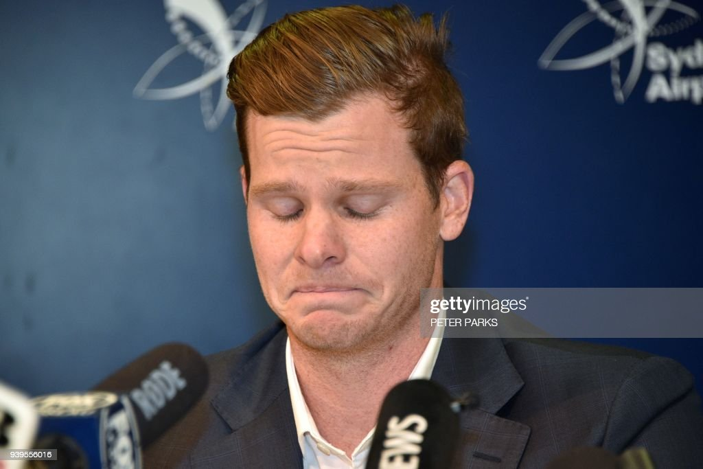 Cricketer Steve Smith reacts at a press conference at the airport in Sydney on March 29, 2018, after returning from South Africa. Distraught Australian cricketer Steve Smith on March 29 accepted full responsibility for a ball-tampering scandal that has shaken the sport, saying he was devastated by his 'big mistake'. /