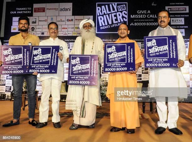 Cricketer Suresh Raina Dy CM Dinesh Sharma Sadhguru UP Chief Minister Yogi Adityanath and Dy CM Keshav Prasad Maurya were present to support the'...