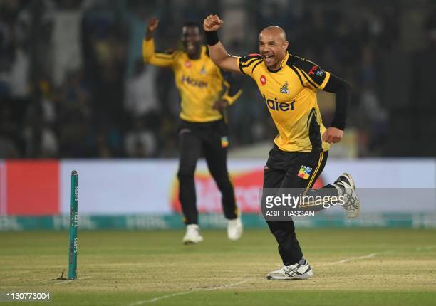 Cricketer Tymal Mills of Peshawar Zalmi celebrates after taking a wicket of Chadwick Walton of Islamabad United during the second elimination PSL...