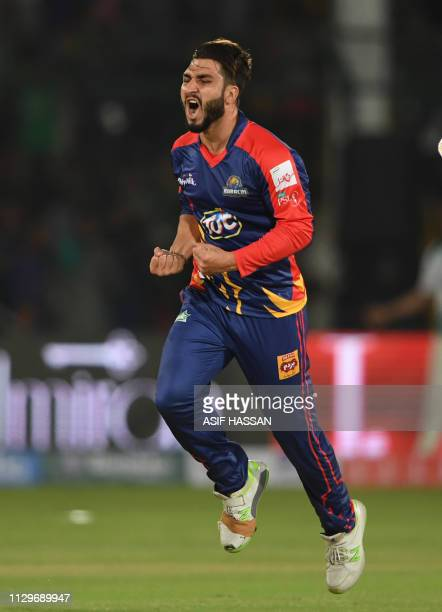 Cricketer Usman Shinwari of Karachi Kings celebrates after his team won the second match of the last eight matches of its domestic Twenty20 League in...